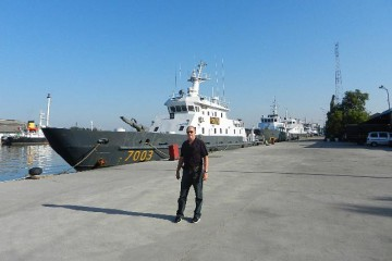 Bill beside Indonesia Marine Police Patrol Boat